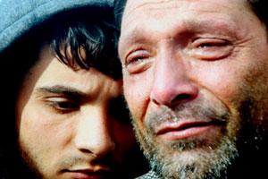 Afganskur faðir sem missti börnin sín í sjóslysi við strendur Farmakonisi.